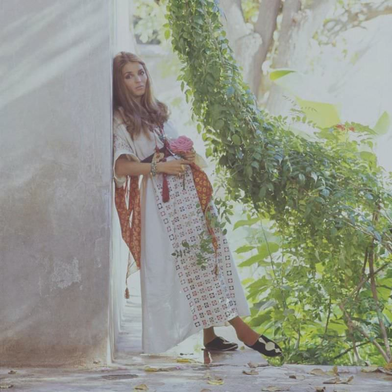 Talitha Getty leaning on a wall with vines by her house in Marrakesh, Morocco, January 15, 1970