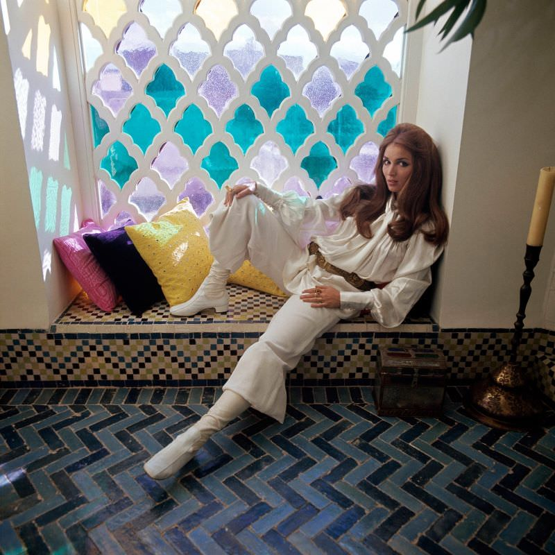 Talitha Getty sitting by a window in her house in Marrakesh, Morocco, January 15, 1970