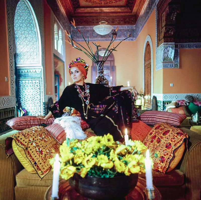 Talitha Getty wearing a turban and kaftan in her living room in Marrakesh, Morocco, January 15, 1970