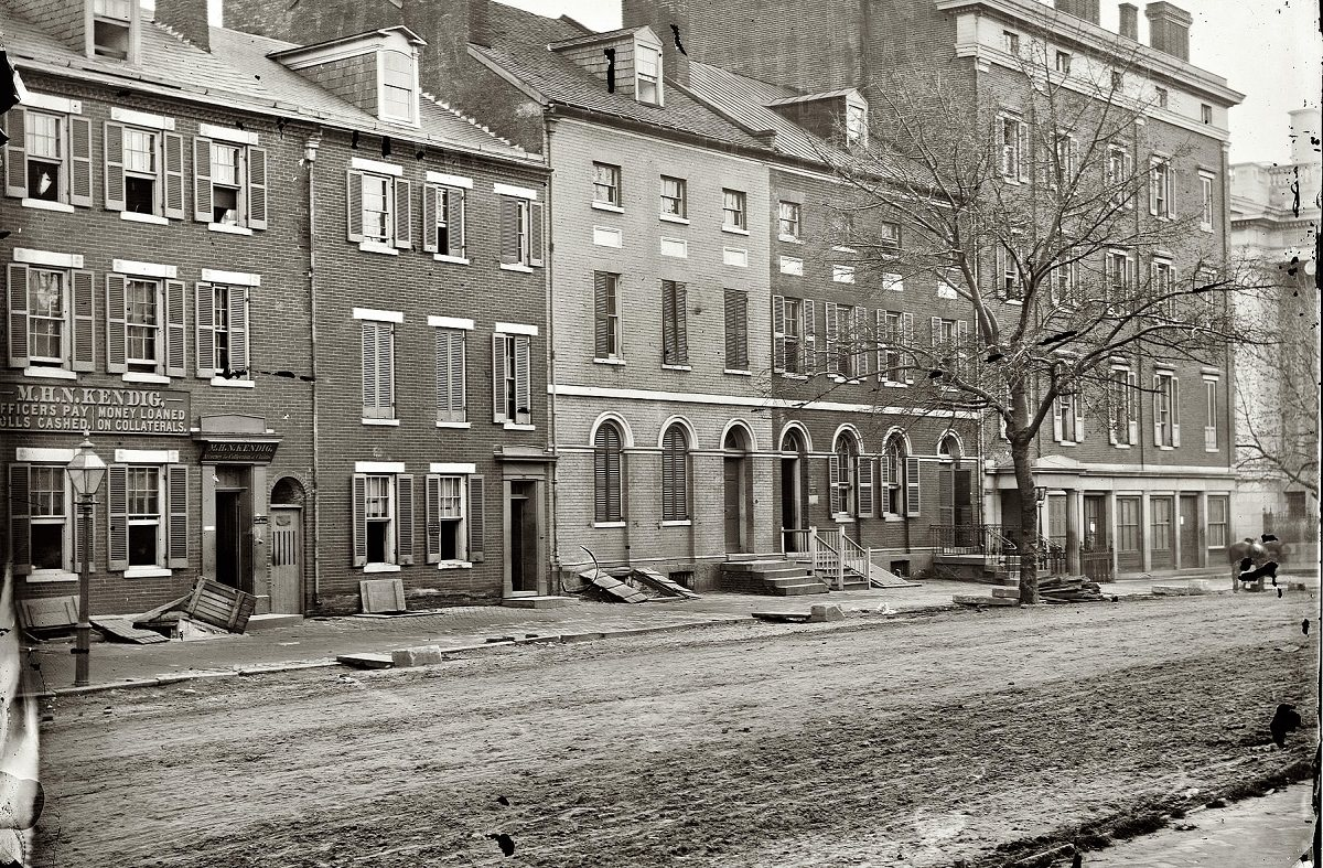 Sanitary Commission storehouse and adjoining houses at 15th and F Streets N.W., Washington, D.C., 1865.