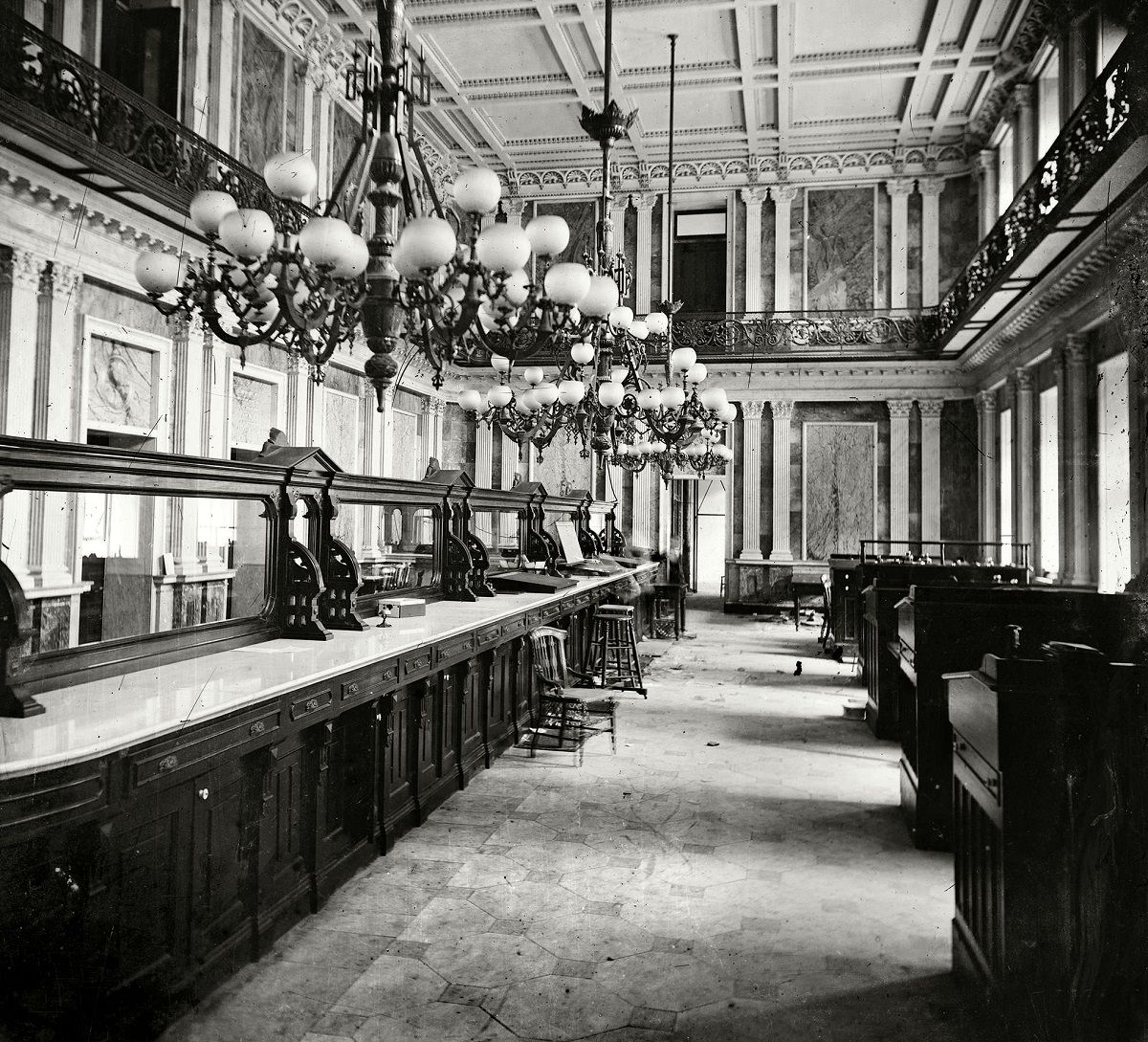 """Treasury Department in Lincoln's time (Cash Room behind the desks)."""" At least two spectral presences here. Civil War glass negative collection, Washington, D.C., 1863."""