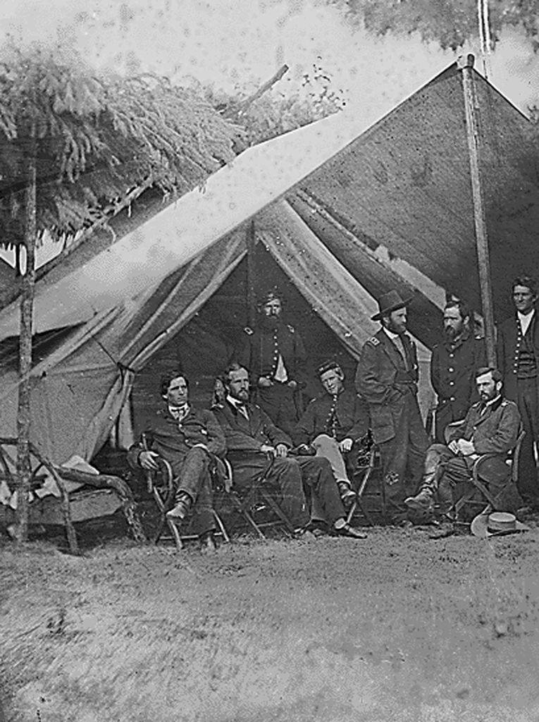 Former US Lt. General Ulysses S. Grant (standing 5th from L) next to a tent with his fellow officers during the US Civil War, 1865.