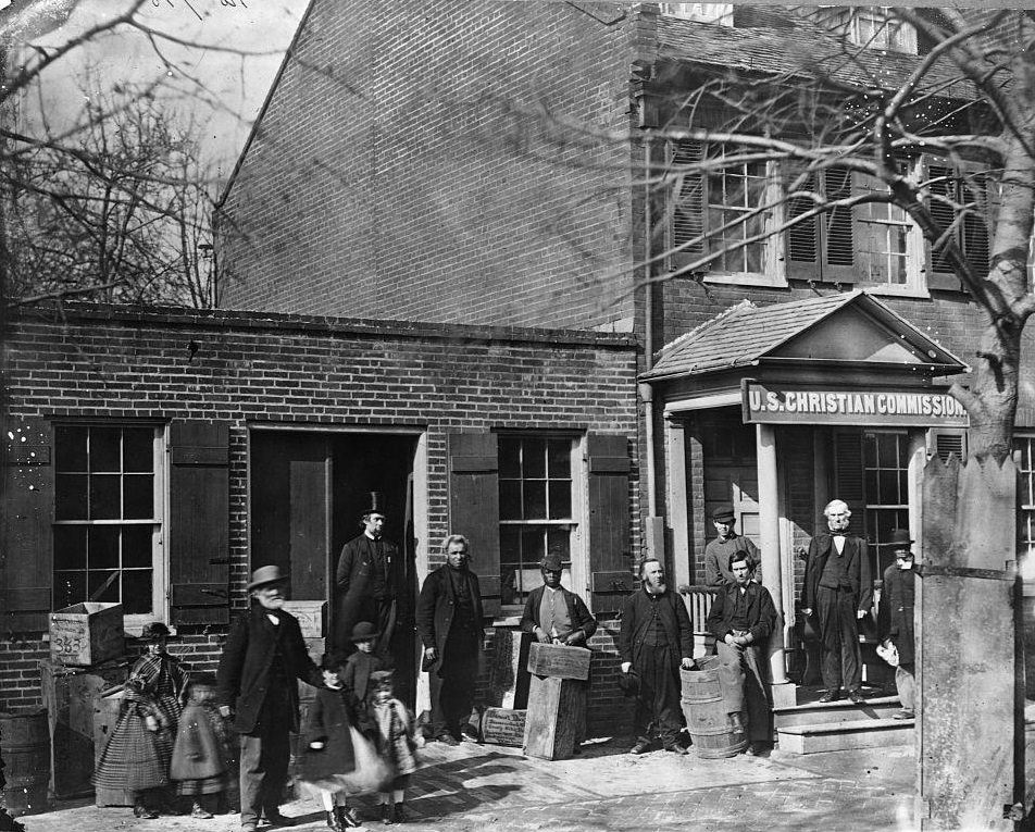 Members of the United States Christian Commission stand outside the organization's Washington D.C. office, 1862.