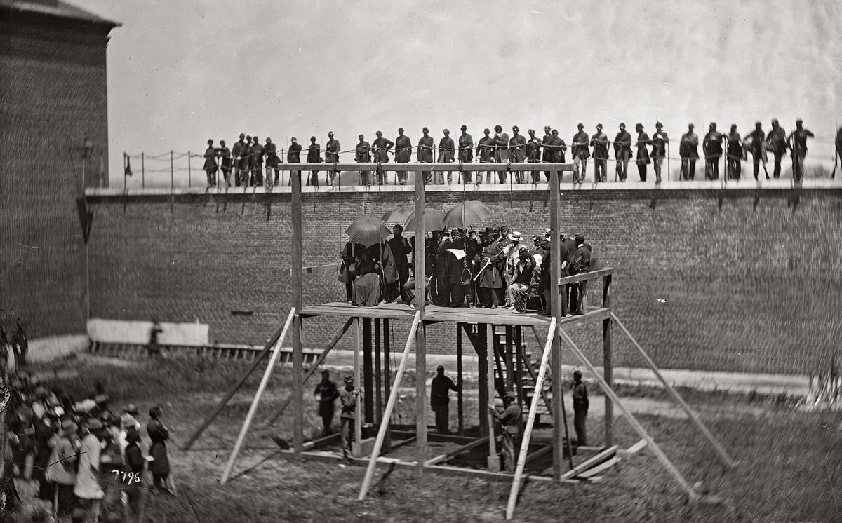 Gen. John F. Hartranft reading the death warrant to the four condemned Lincoln assassination conspirators, July 7, 1865