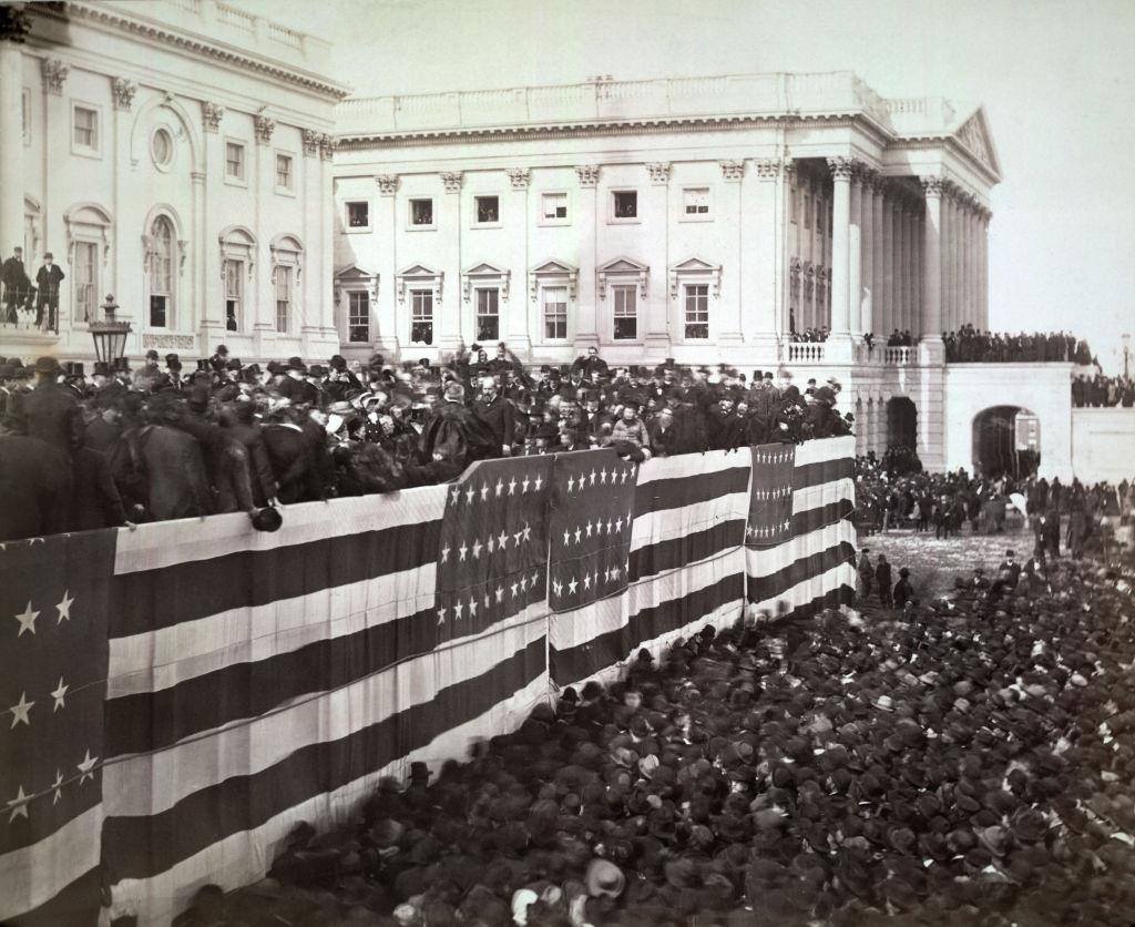 Chief Justice Morrison R Waite administering the oath of office to James A Garfield on the east portico of the US Capitol, Washington DC, 1881