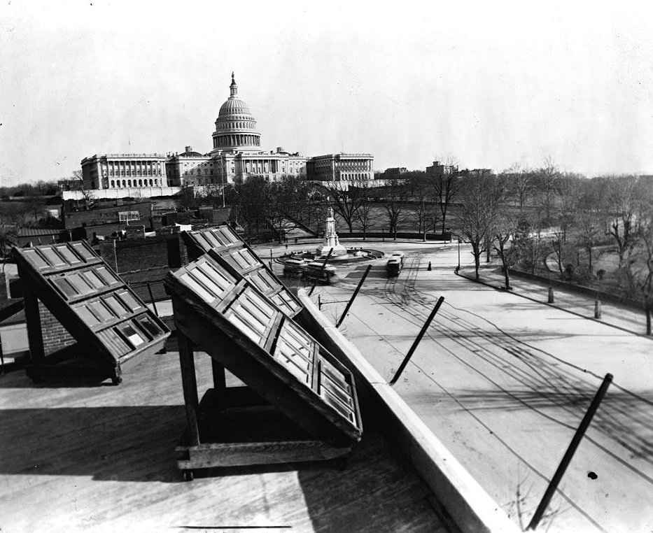 Glass photographic negatives are sun-printed on the roof of J. F. Jarvis' photo store in Washington D. C., 1890s